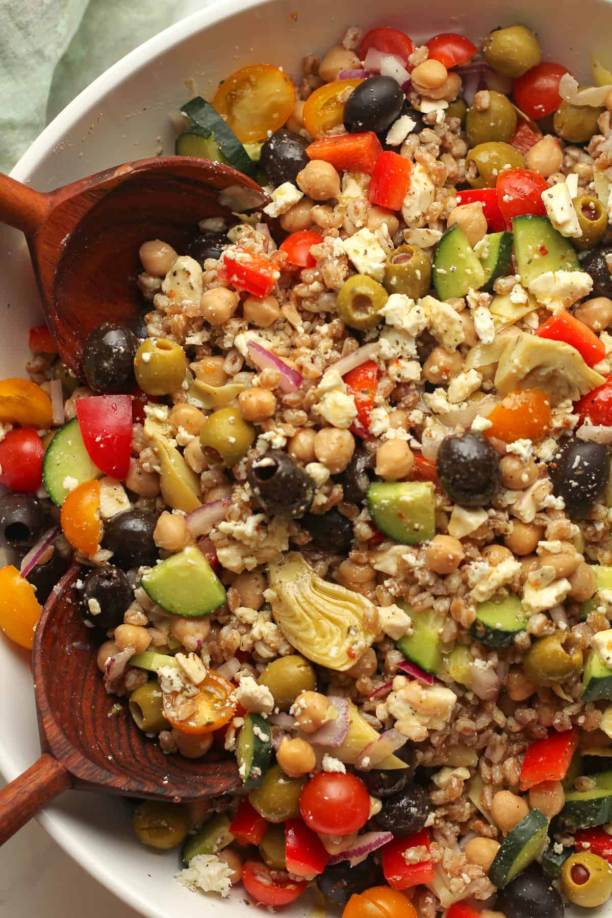 Closeup on Greek farro salad with dressing.