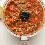 A food processor of grilled salsa.