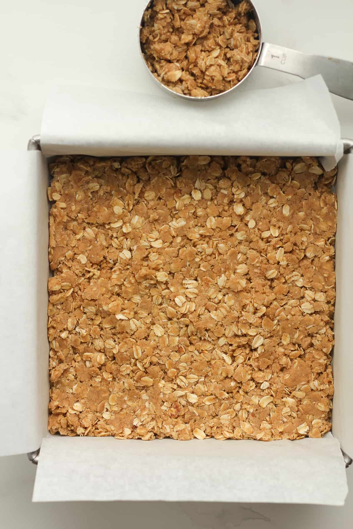 A pan of the pressed crumble layer.