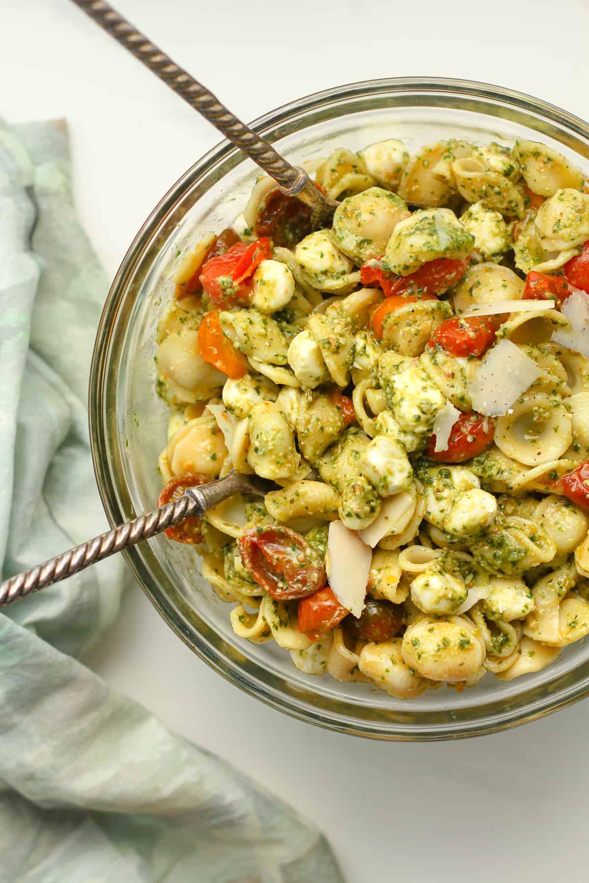 A bowl of pesto pasta salad.