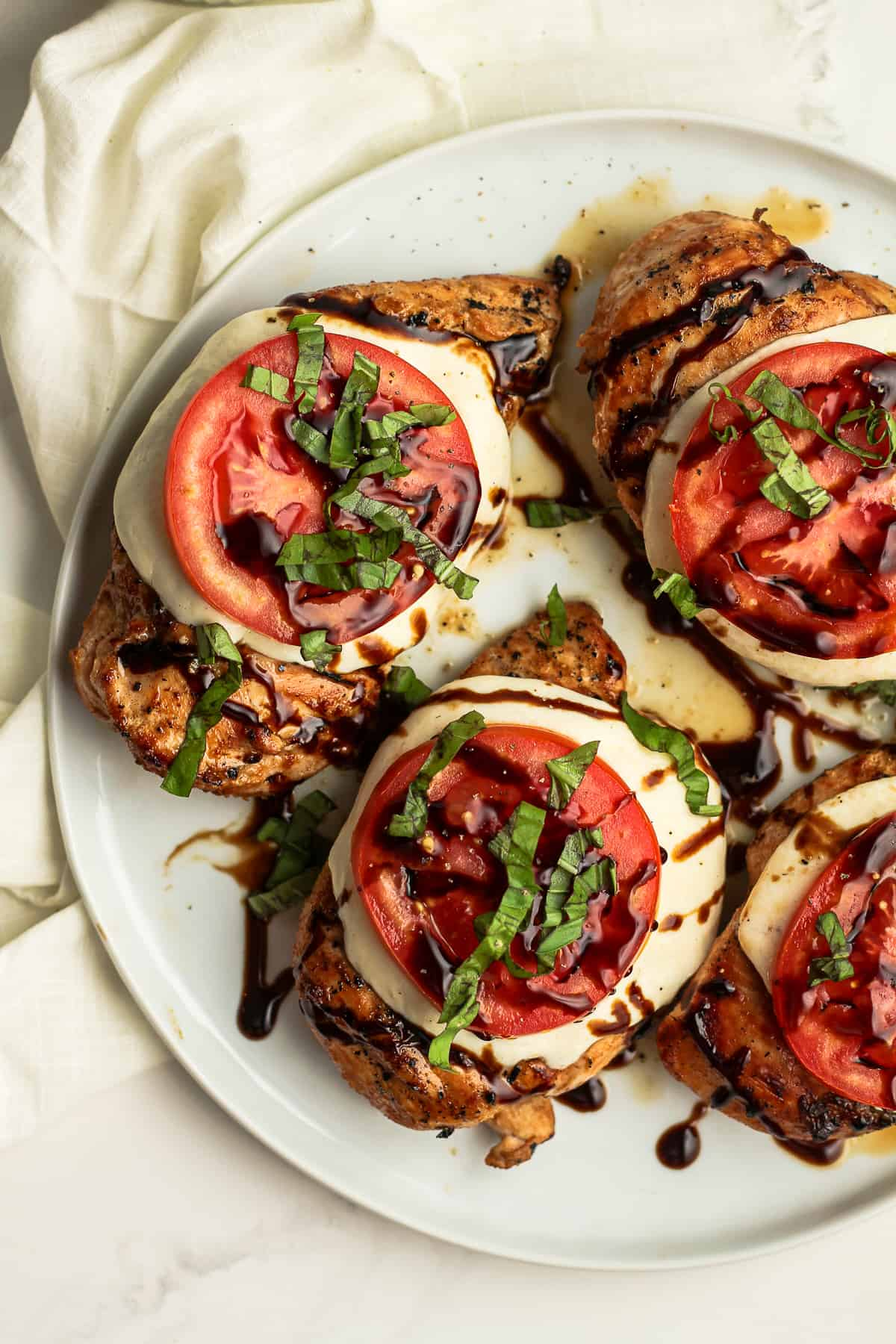 A plate of chicken Caprese.
