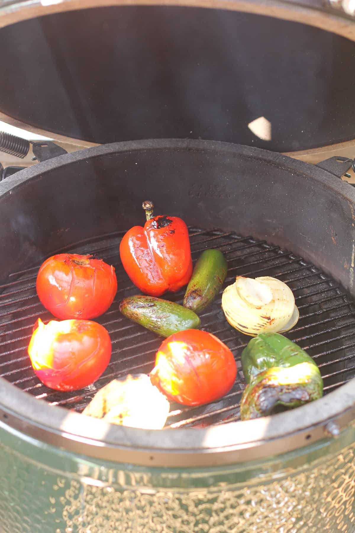 Side shot of a grill with veggies.