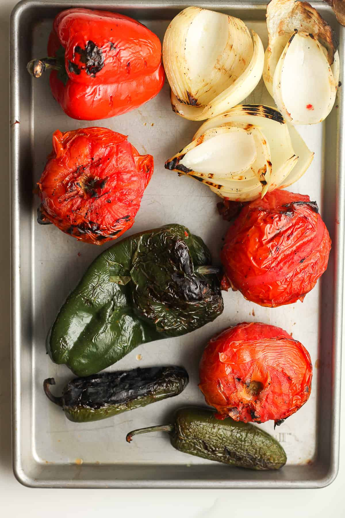 A sheet pan with the grilled veggies.