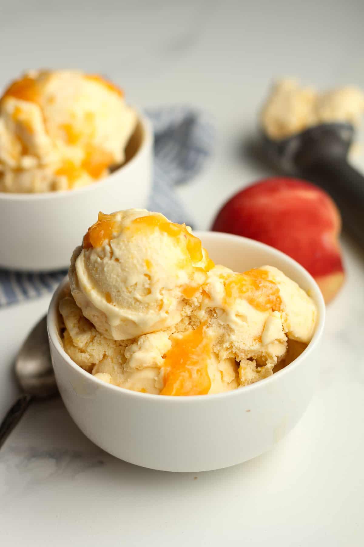 Closeup on a bowl of peach ice cream.
