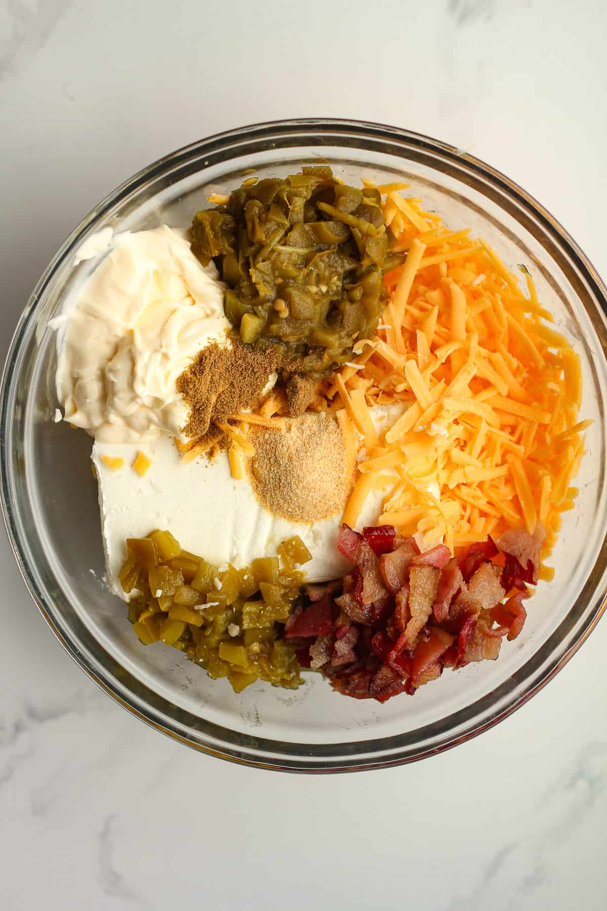 A glass bowl of the dip ingredients.