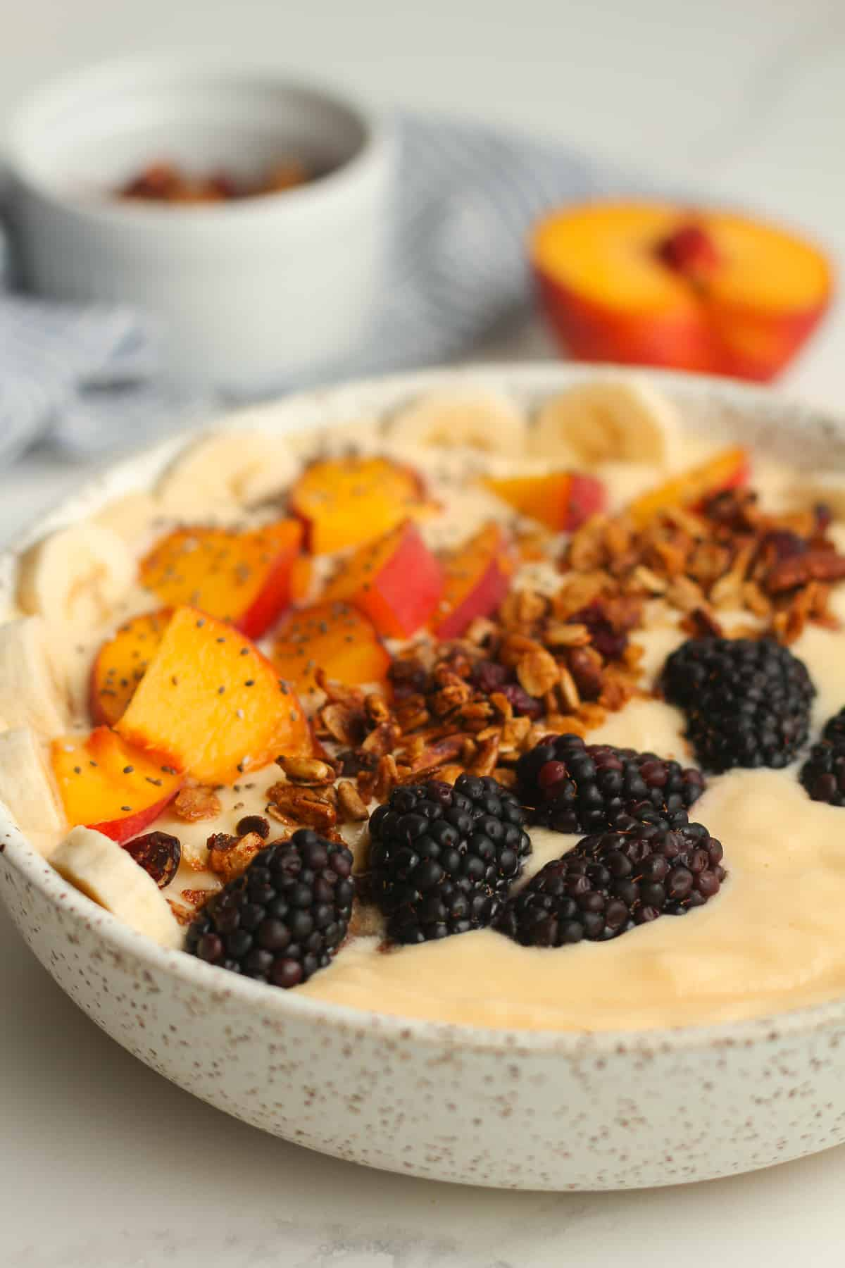 Side shot of a peach smoothie bowl.