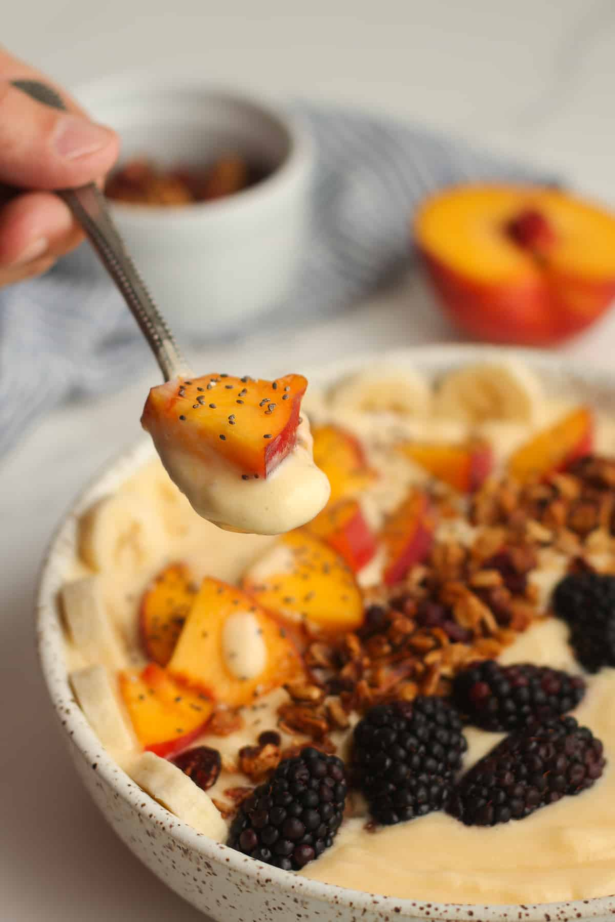 A spoonful of peach smoothie bowl.