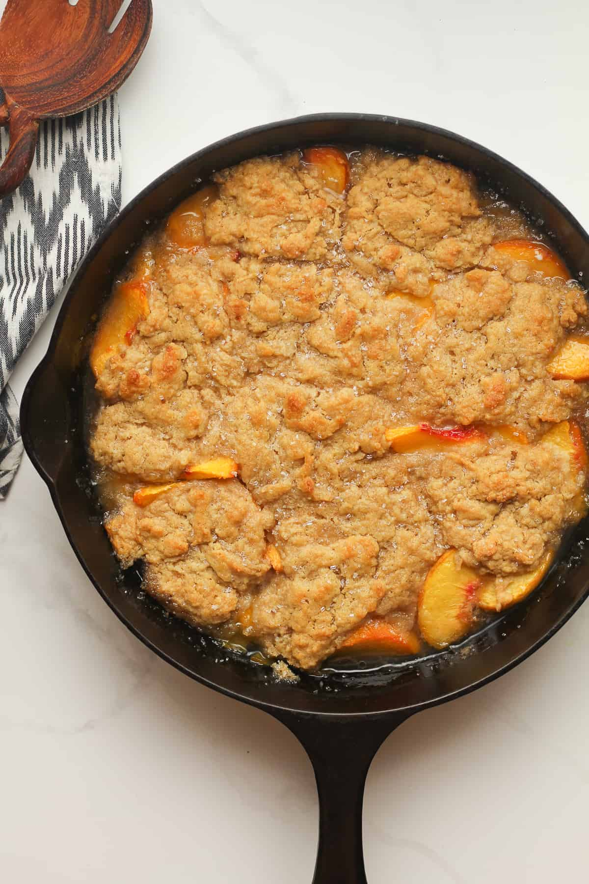 A skillet of peach cobbler just baked.
