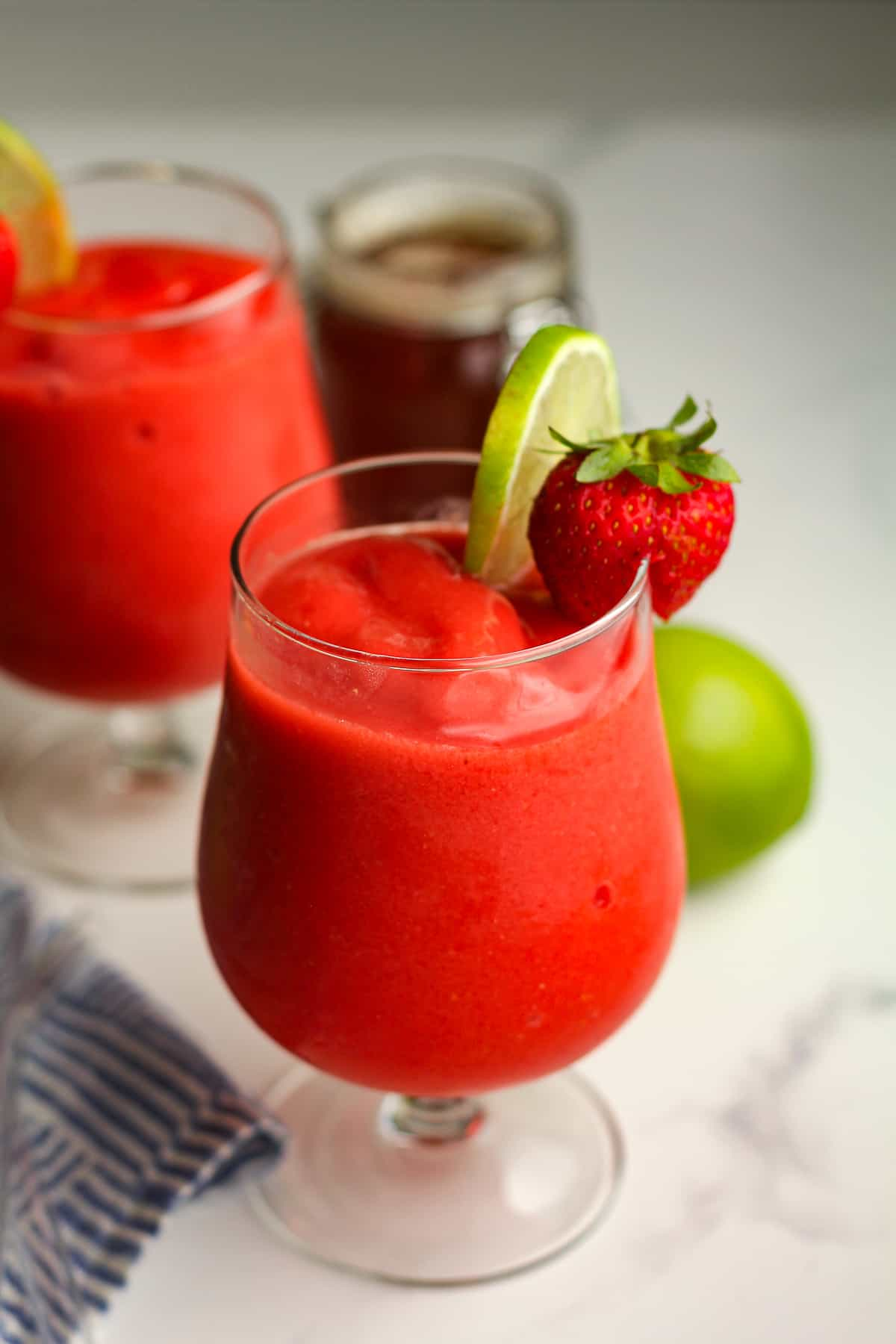 Two glasses of strawberry daiquiri mocktails.
