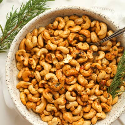Some rosemary cashews with rosemary sprigs.
