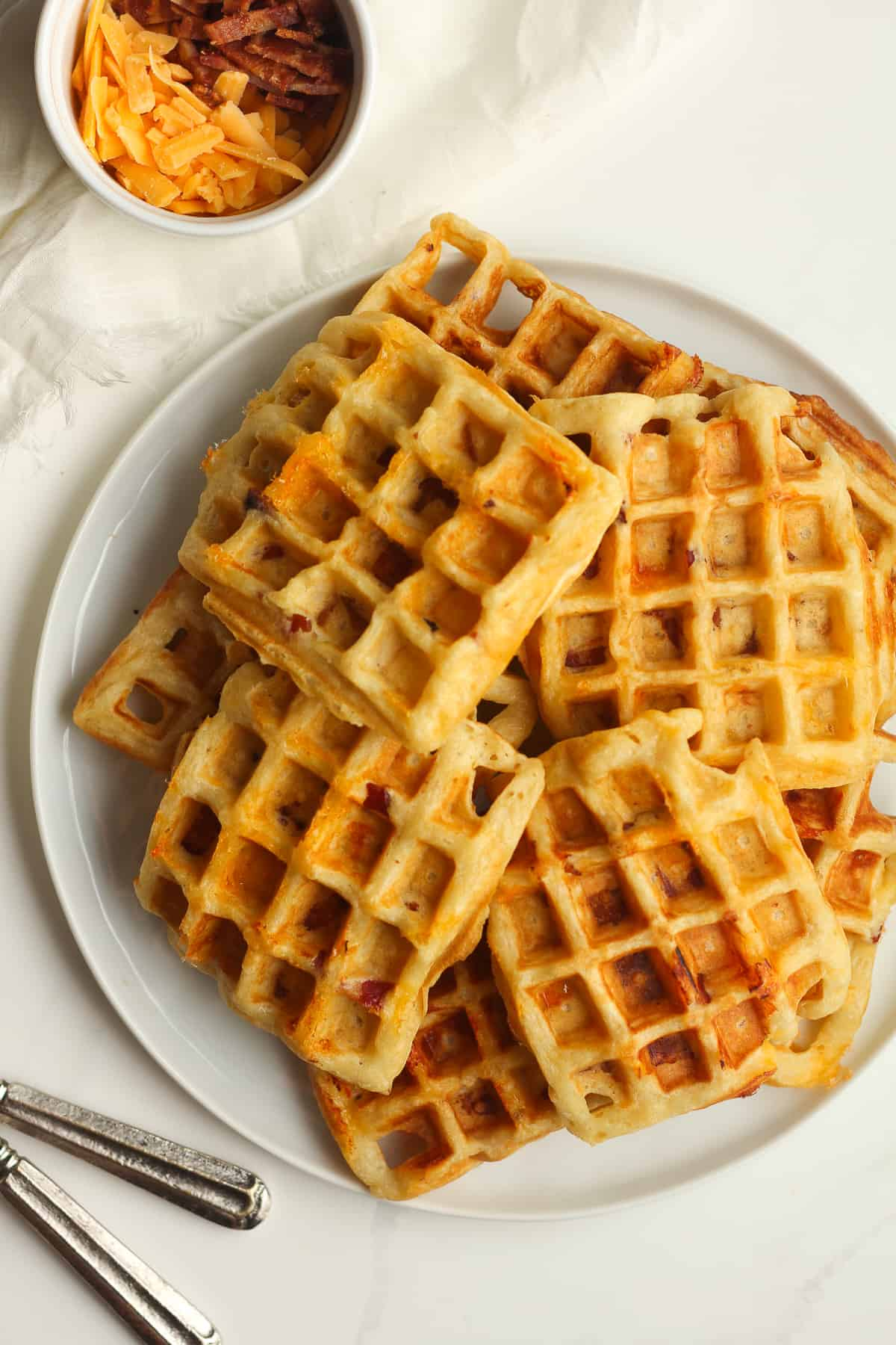 A plate of bacon cheddar waffles.