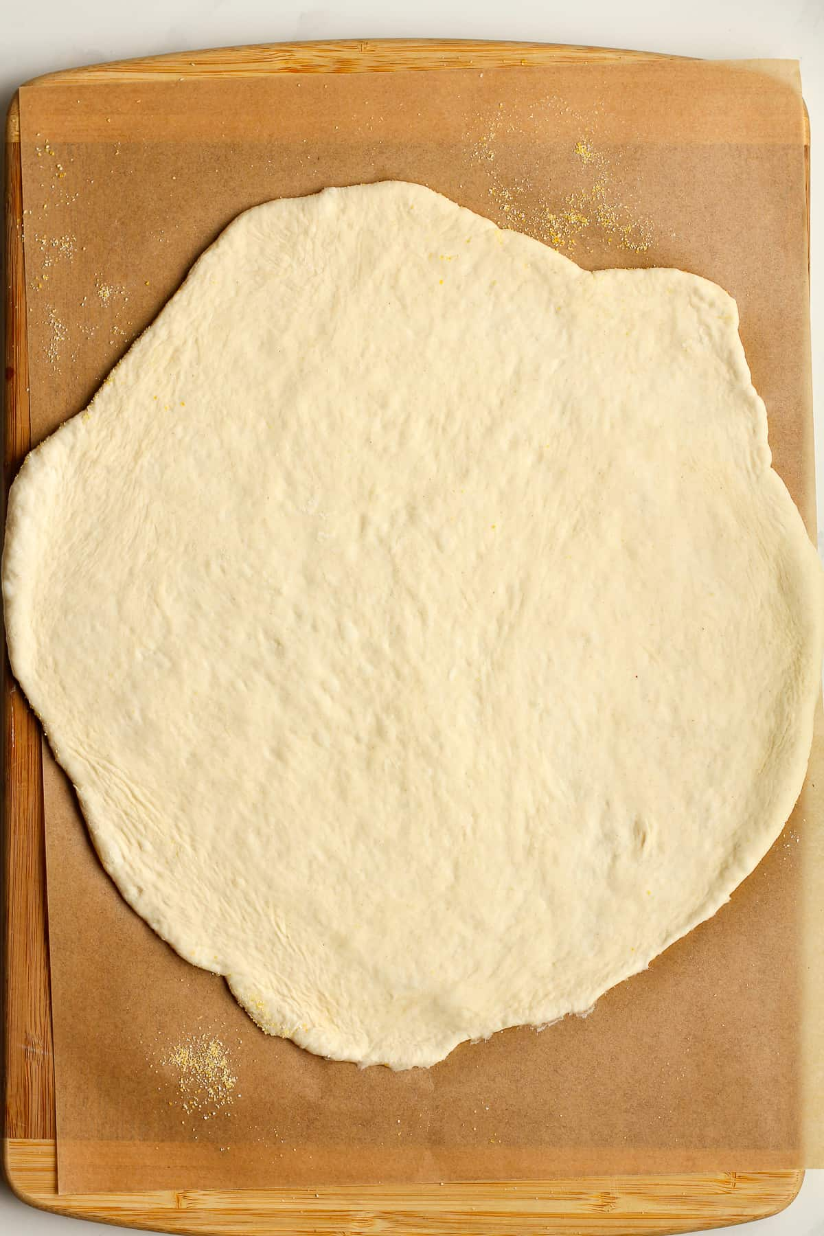 The pizza dough rolled out.