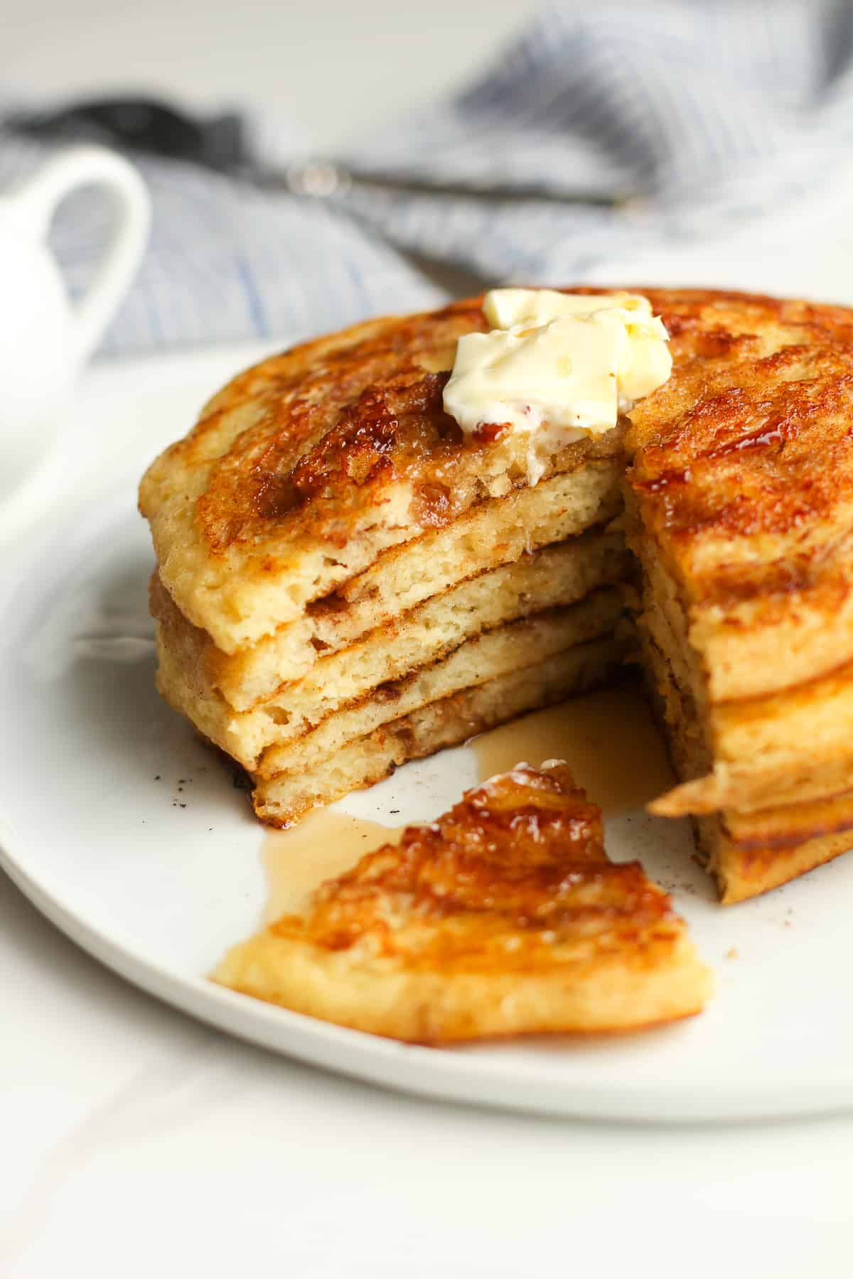 Side shot of a stack of swirl pancakes with butter.