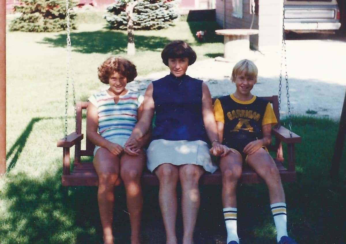 Mom, Rob, and I sitting on the swing.