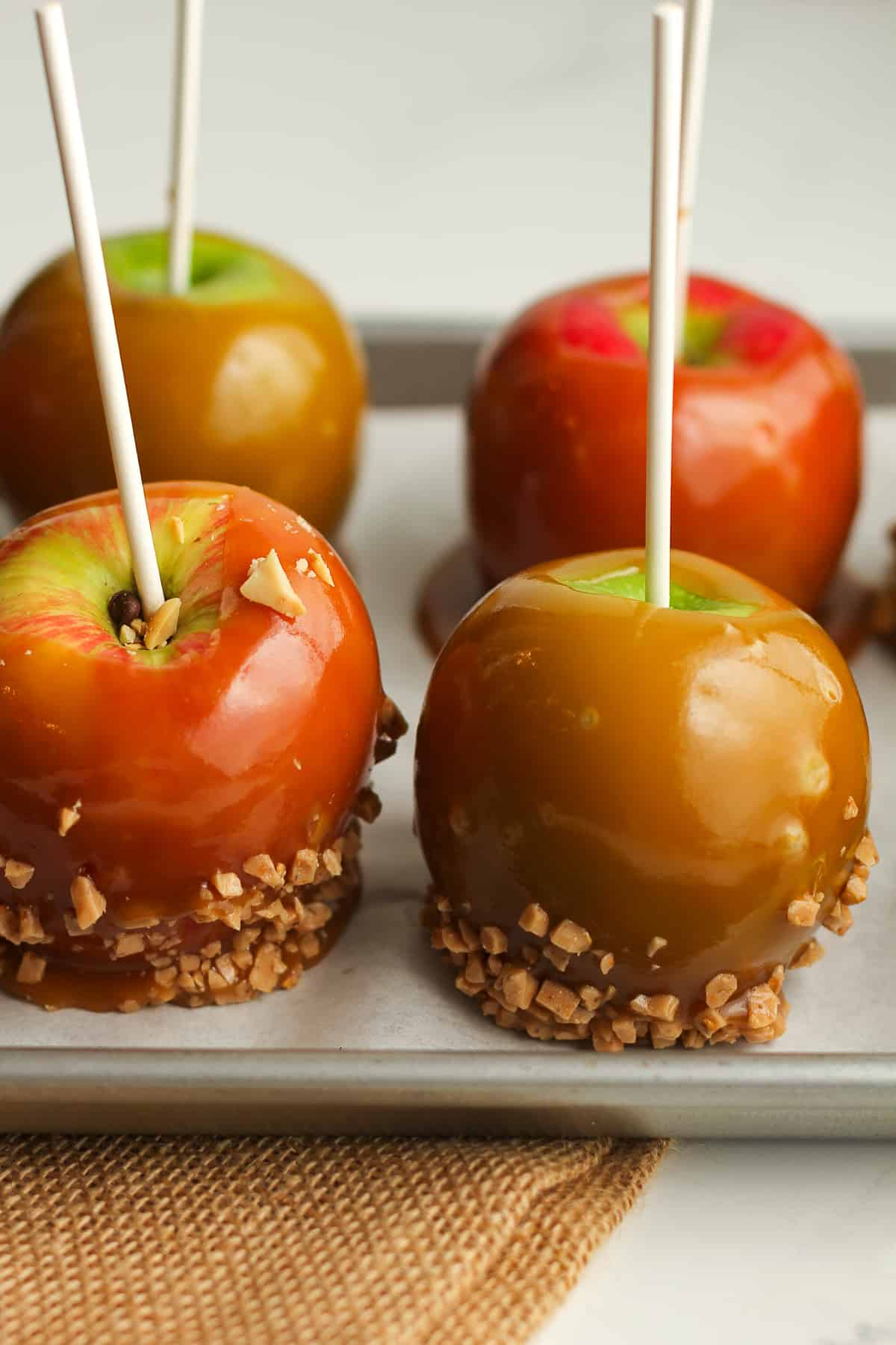 Side view of a pan with caramel apples.