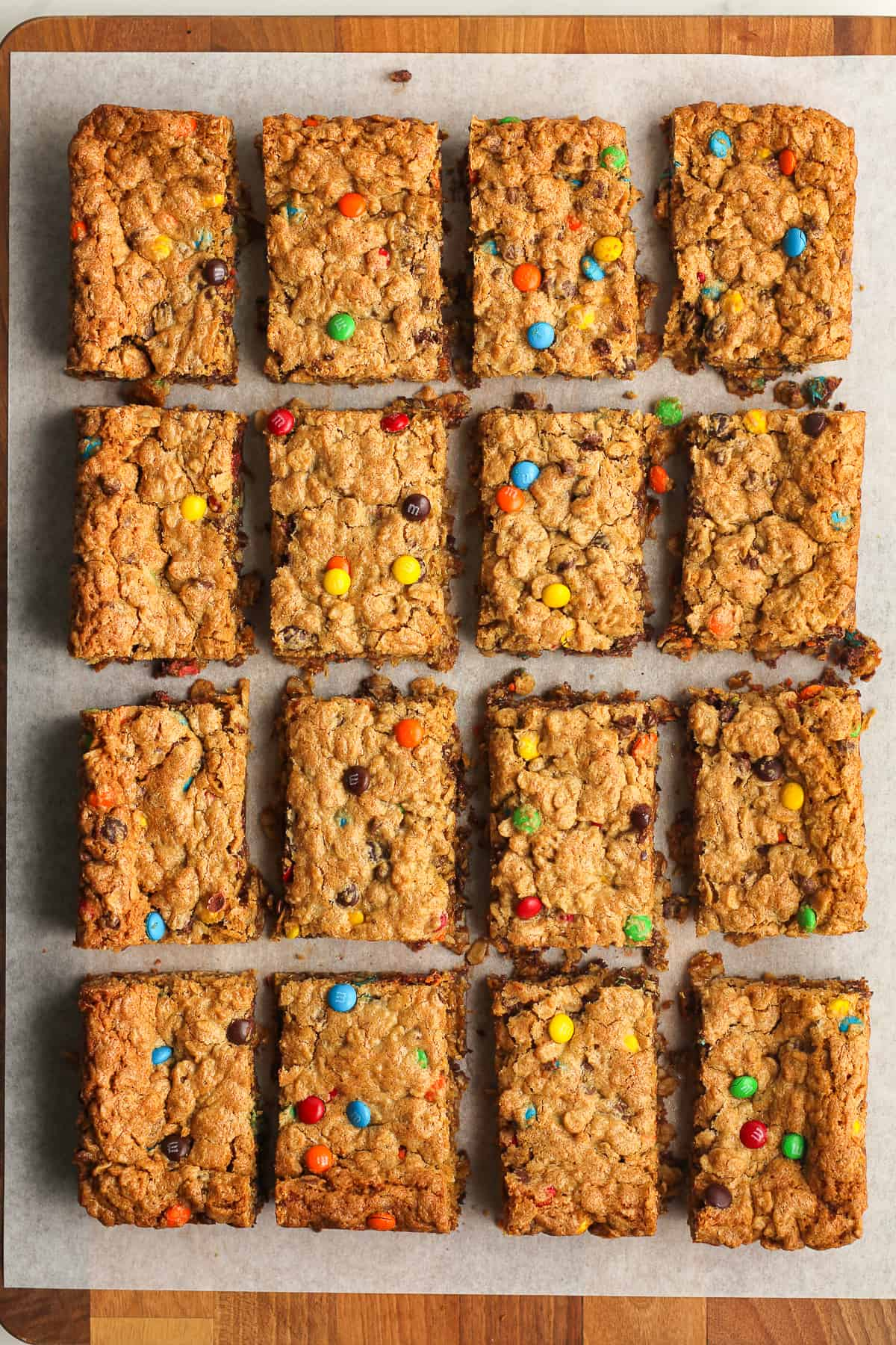Sliced monster cookie bars on a board.
