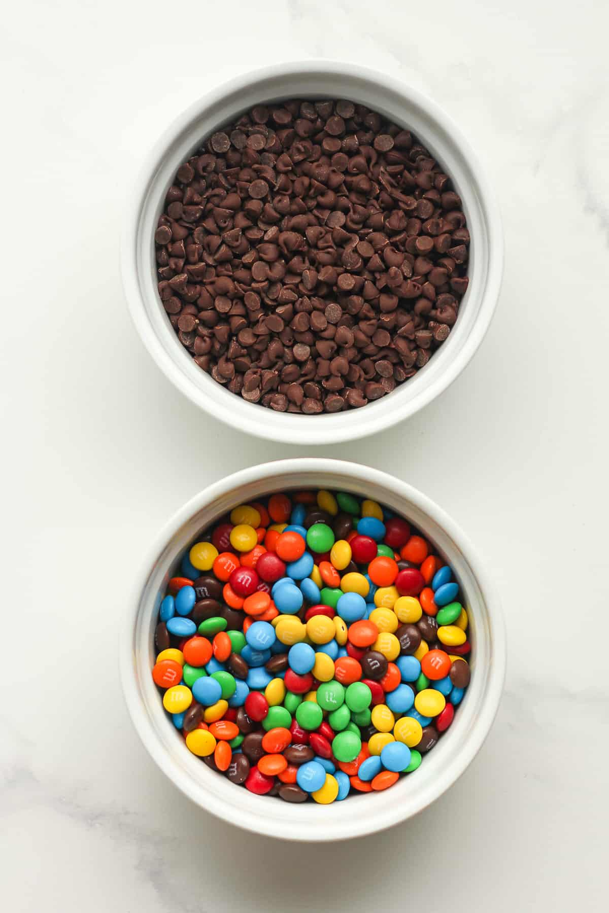 Bowls of the mini chocolate chips and the mini m&ms.