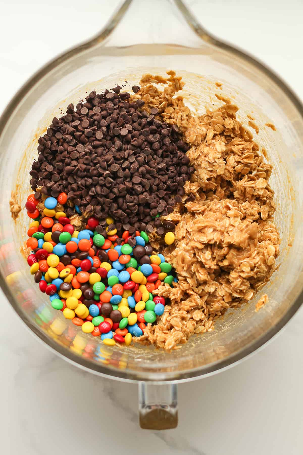 The mixing bowl with the dough plus mini chocolate chips and mini m&ms.