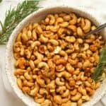 A bowl of roasted rosemary cashews.