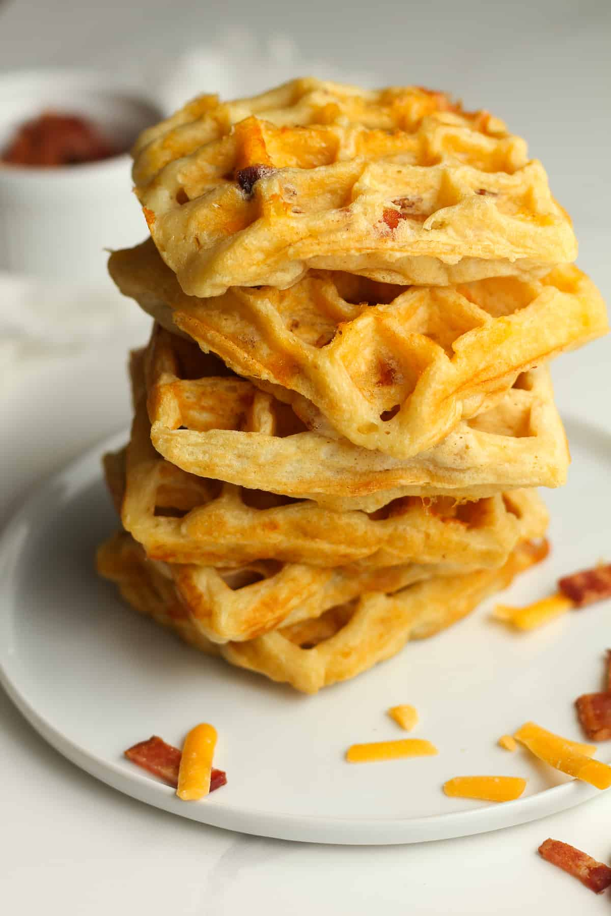 A stack of bacon cheddar waffles.
