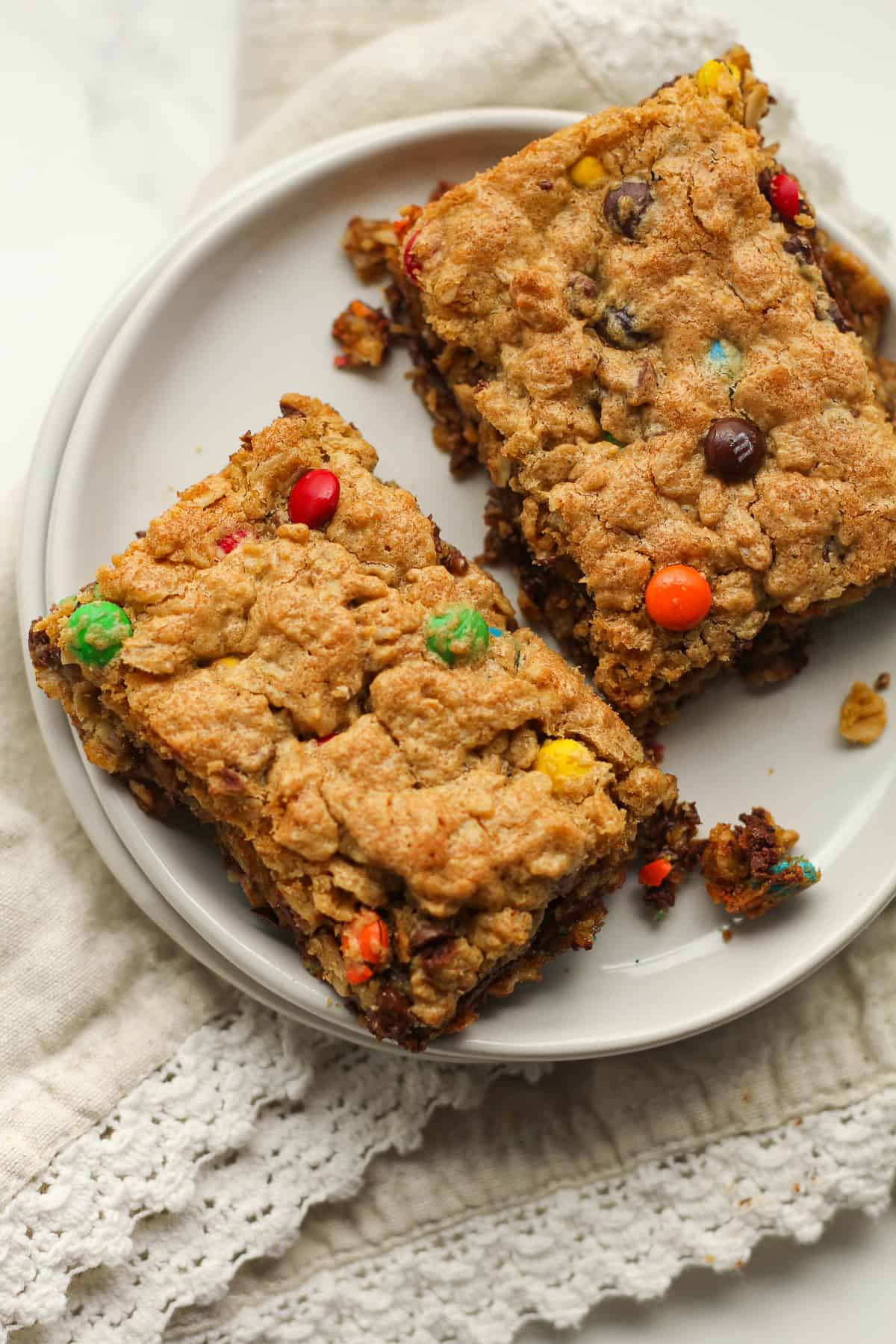 Two monster cookie bars on a plate.