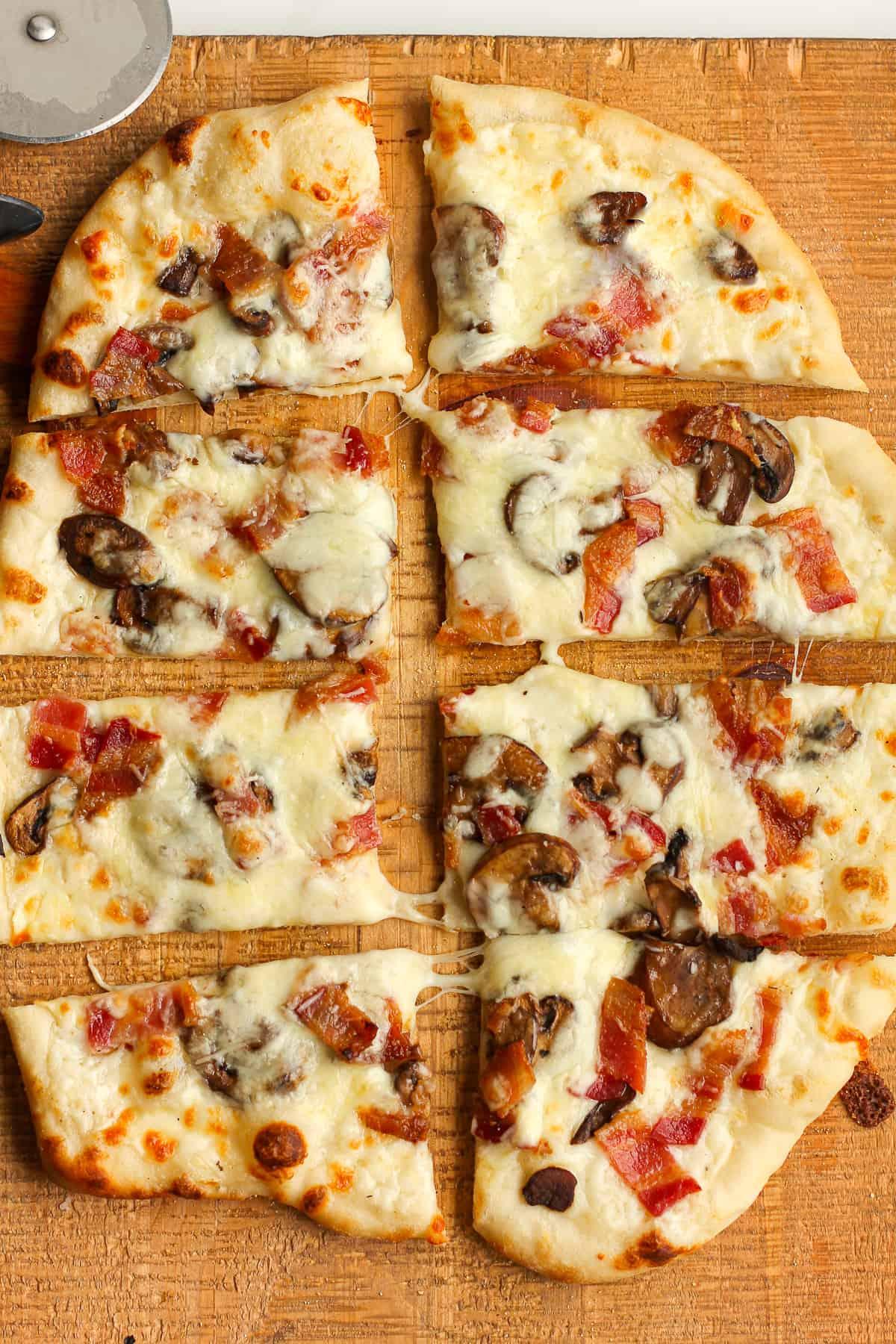 Sliced white sauce pizza.