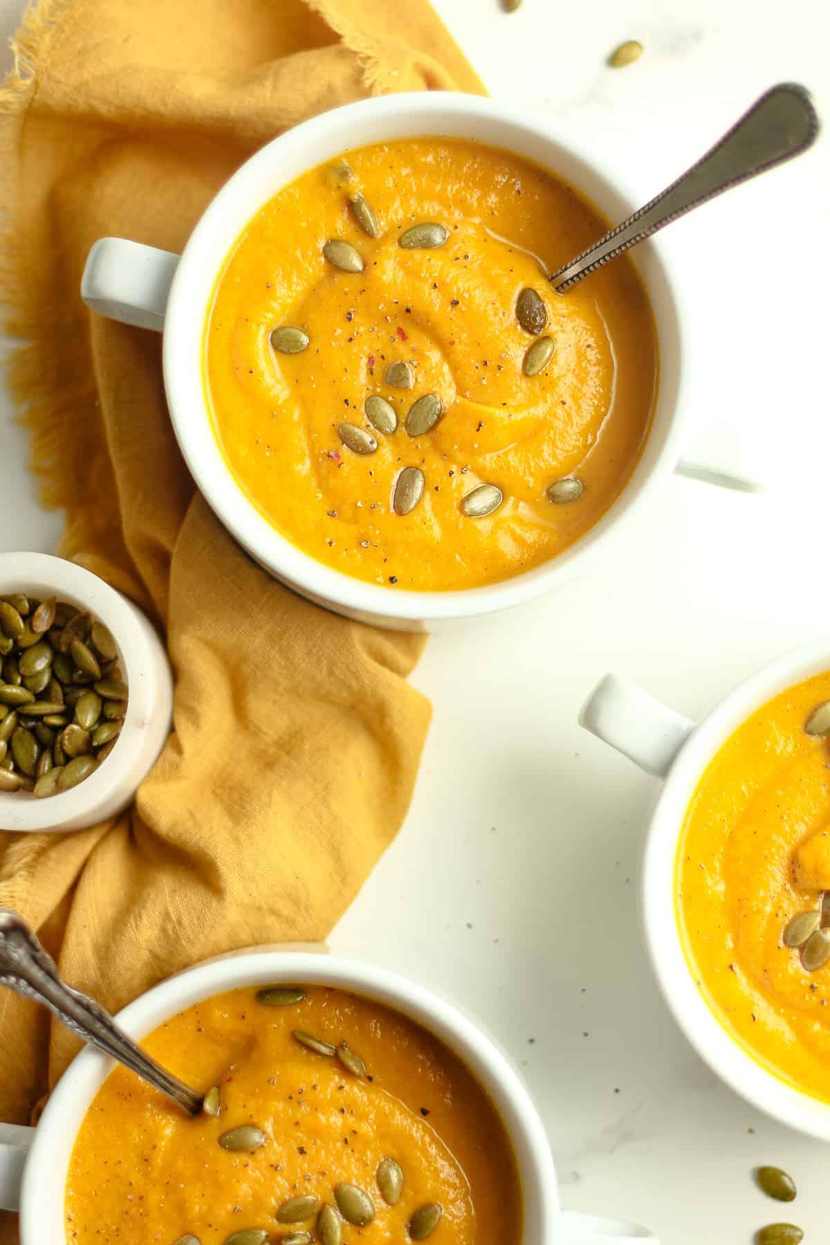 Overhead shots of autumn soup with pumpkin seeds.