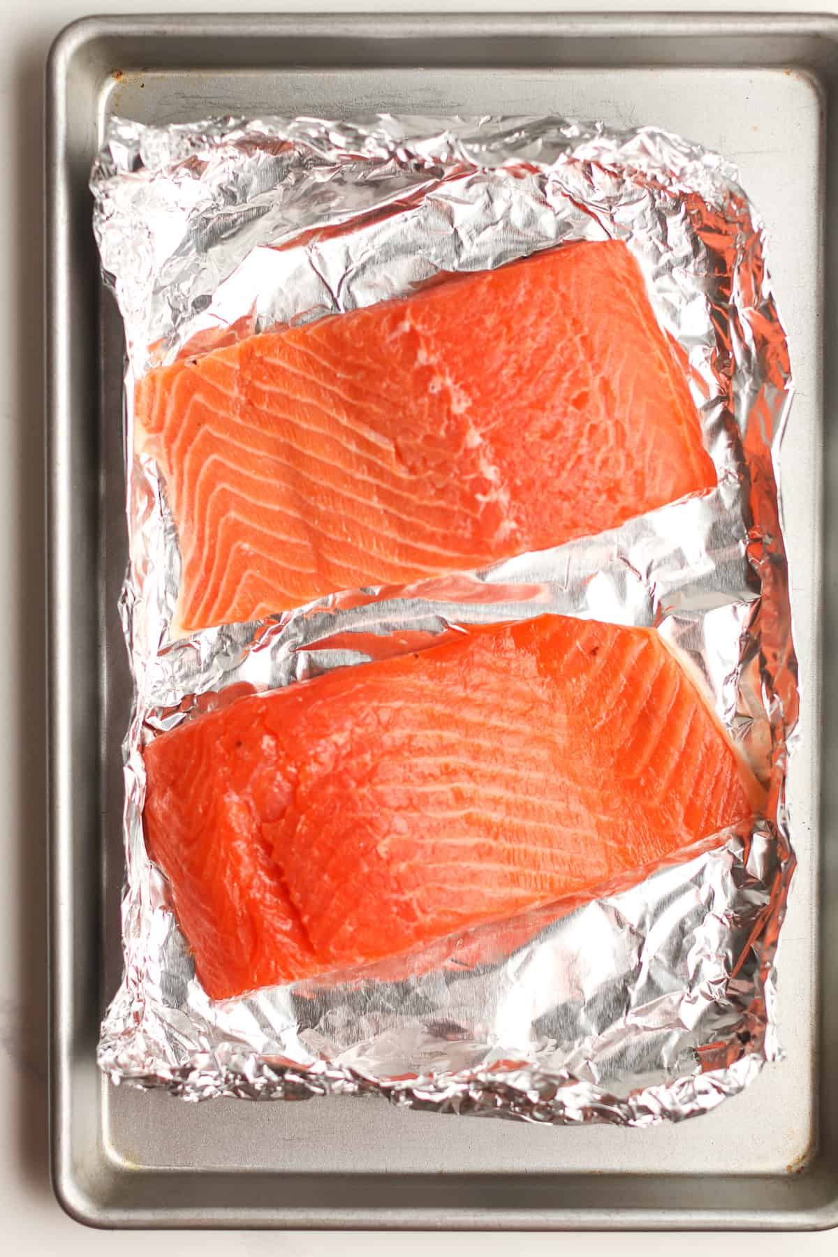 Two pieces of salmon in foil.
