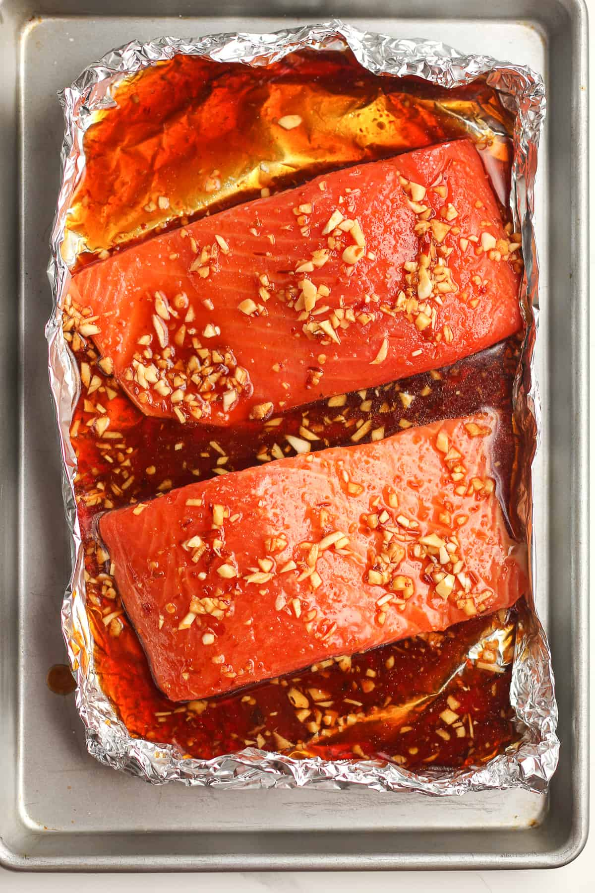 The raw salmon in foil before baking.