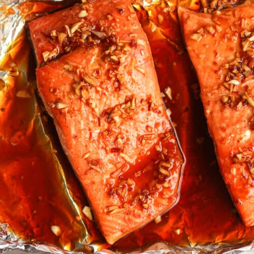 Overhead shot of a chunk of baked salmon with marinade.