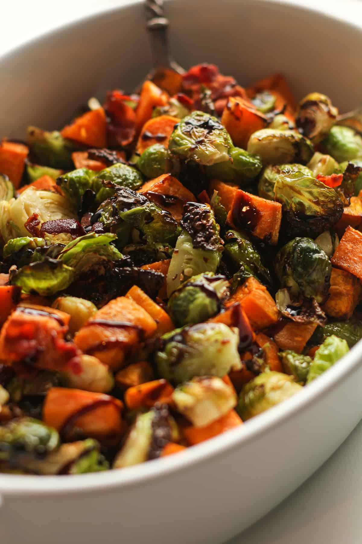 The glazed veggies in a dish.