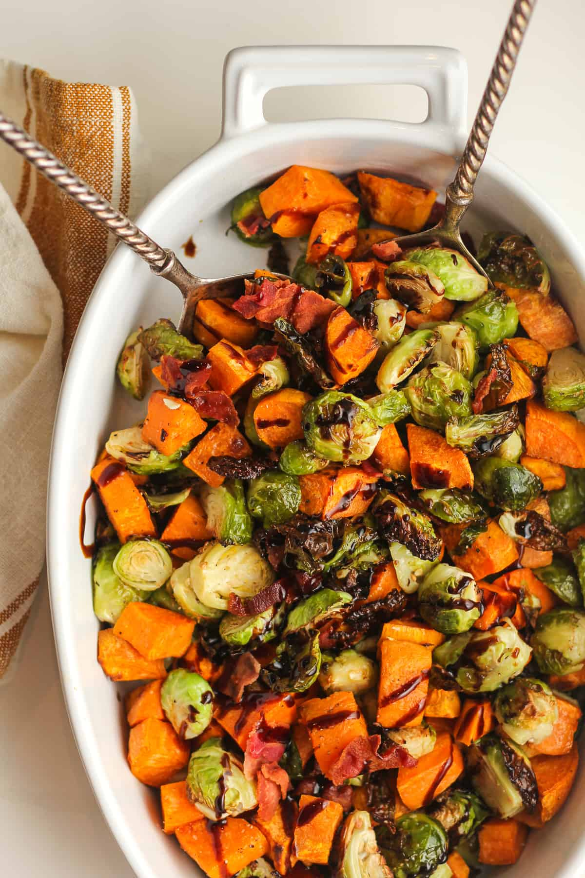 Overhead shot of a dish of balsamic glazed Brussels sprouts and sweet potatoes.
