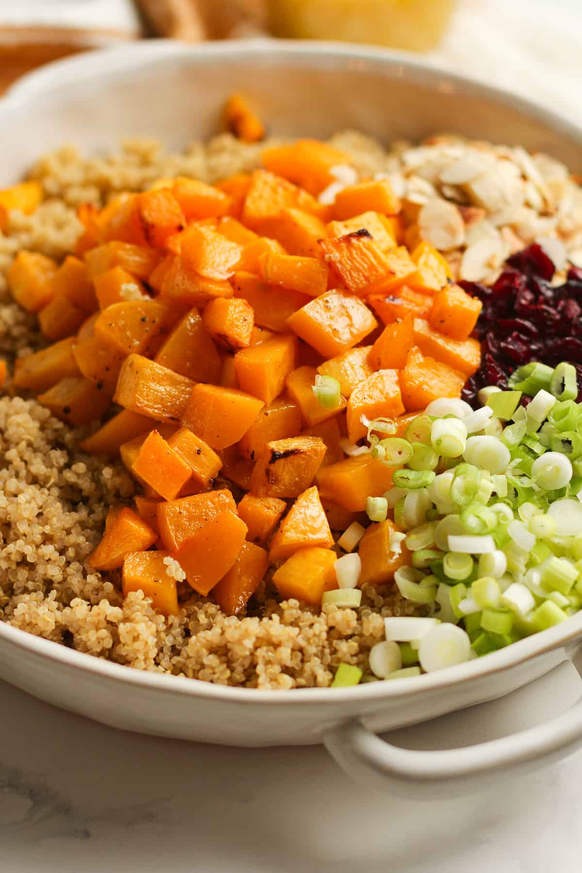 A bowl of the quinoa and toppings by ingredient.