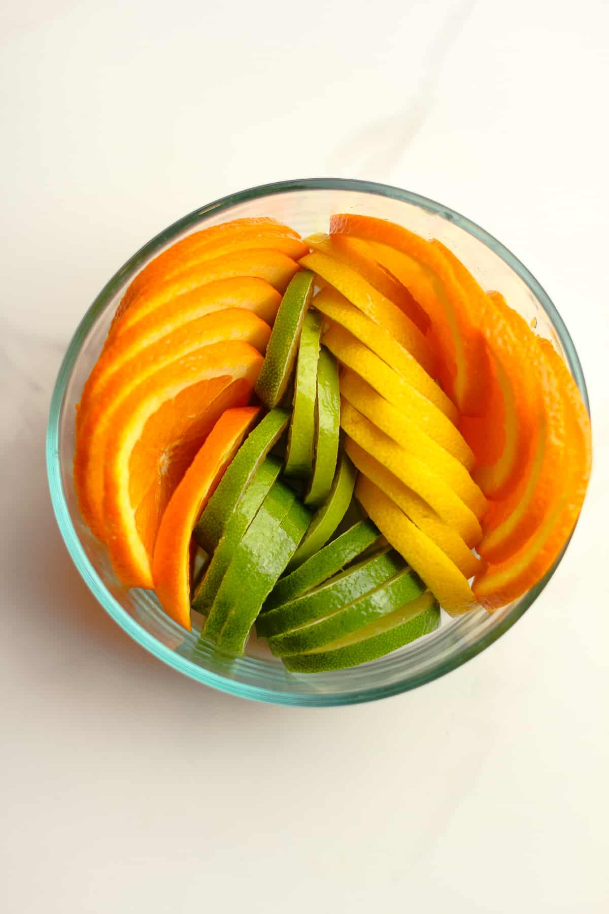 A bowl of the sliced citrus.