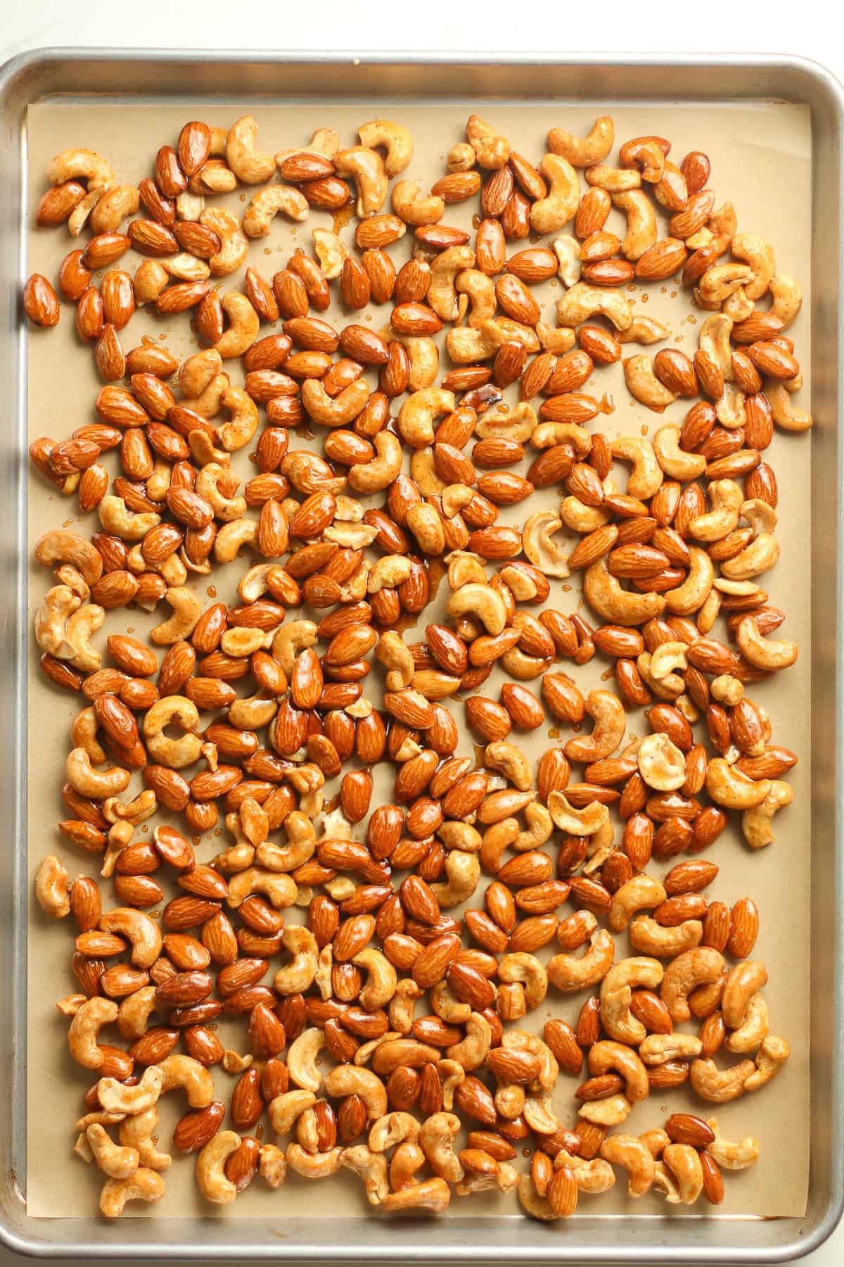 A sheet pan of the nuts ready to go in the oven.