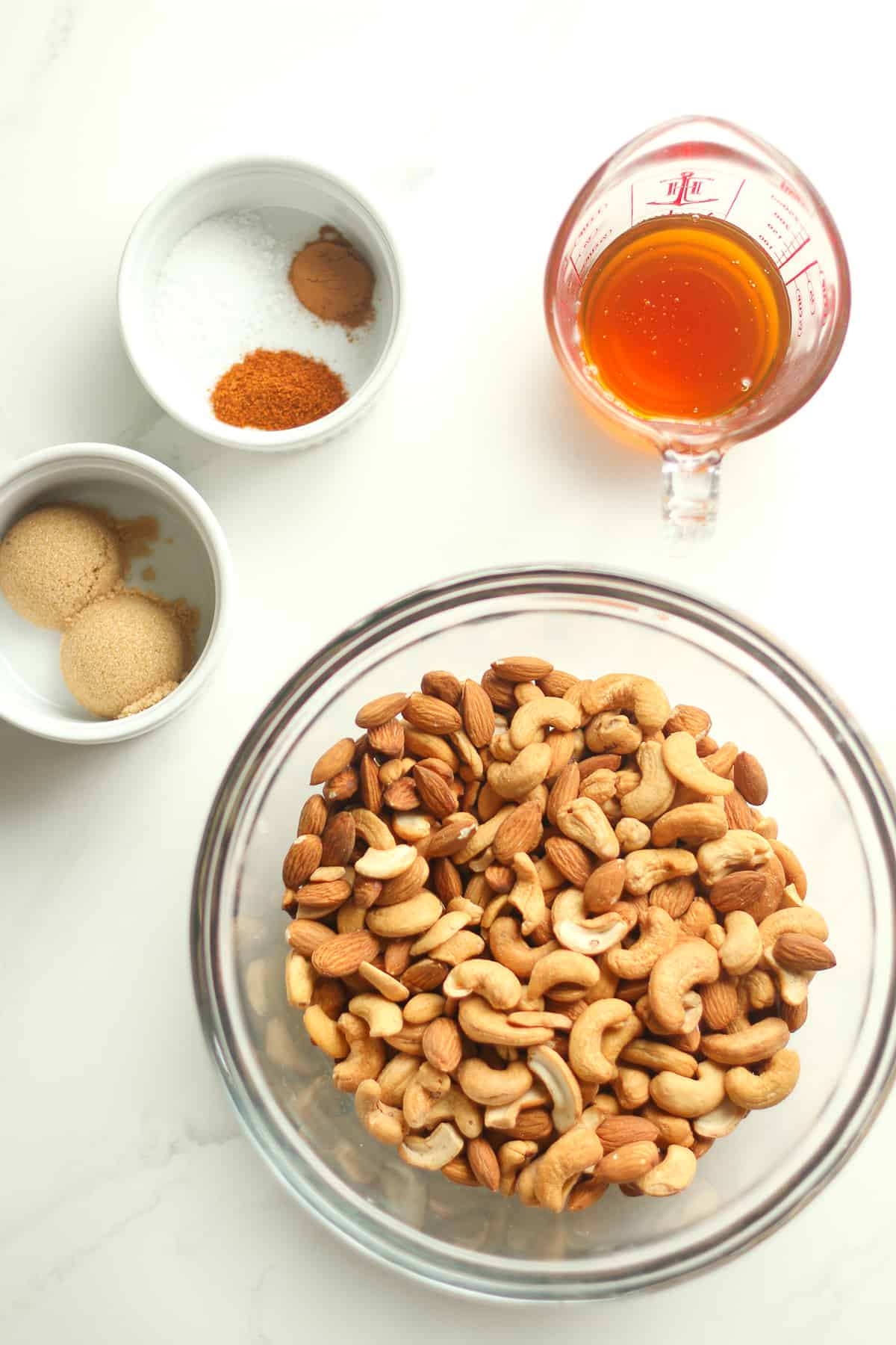 The ingredients for the nuts, including honey, sugar, and spices.